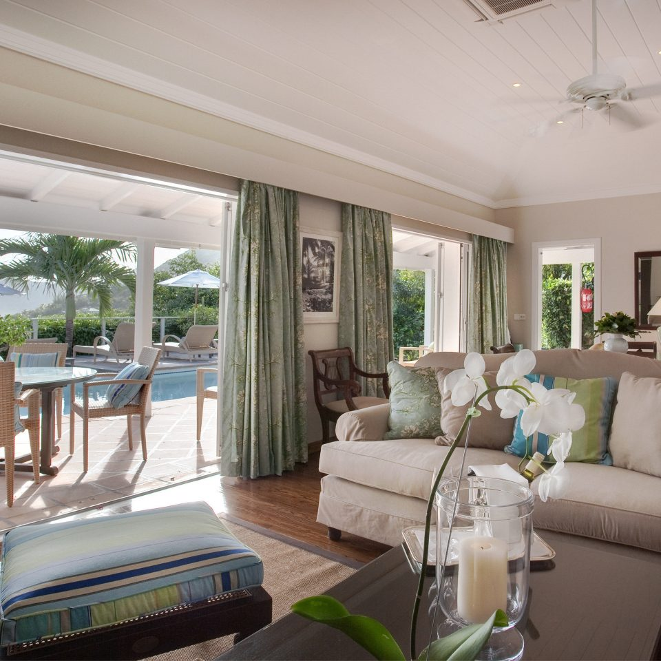 Beachfront Patio Pool Resort Scenic views Villa sofa property living room condominium home green cottage Suite mansion