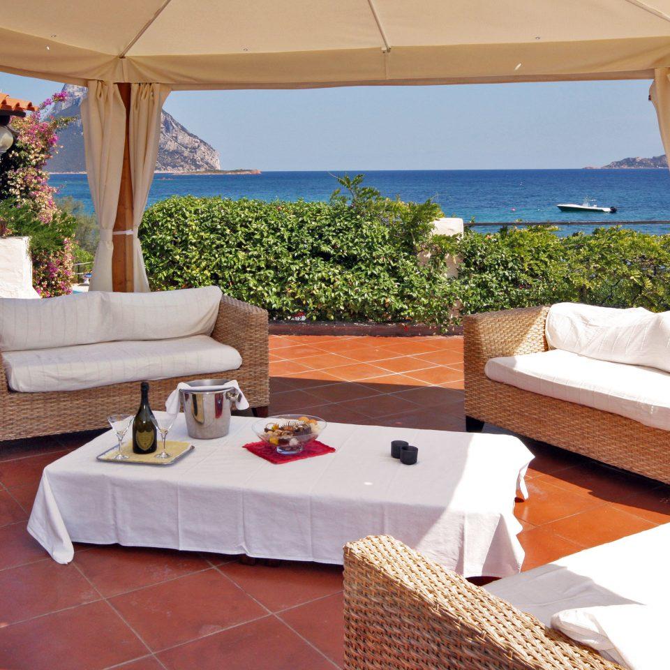 Beachfront Patio Romance Waterfront property swimming pool Resort Villa living room Suite home cottage backyard