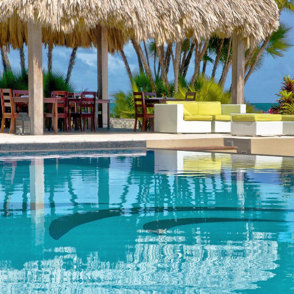 Beachfront Play Pool Resort water tree umbrella leisure swimming pool property condominium swimming Villa