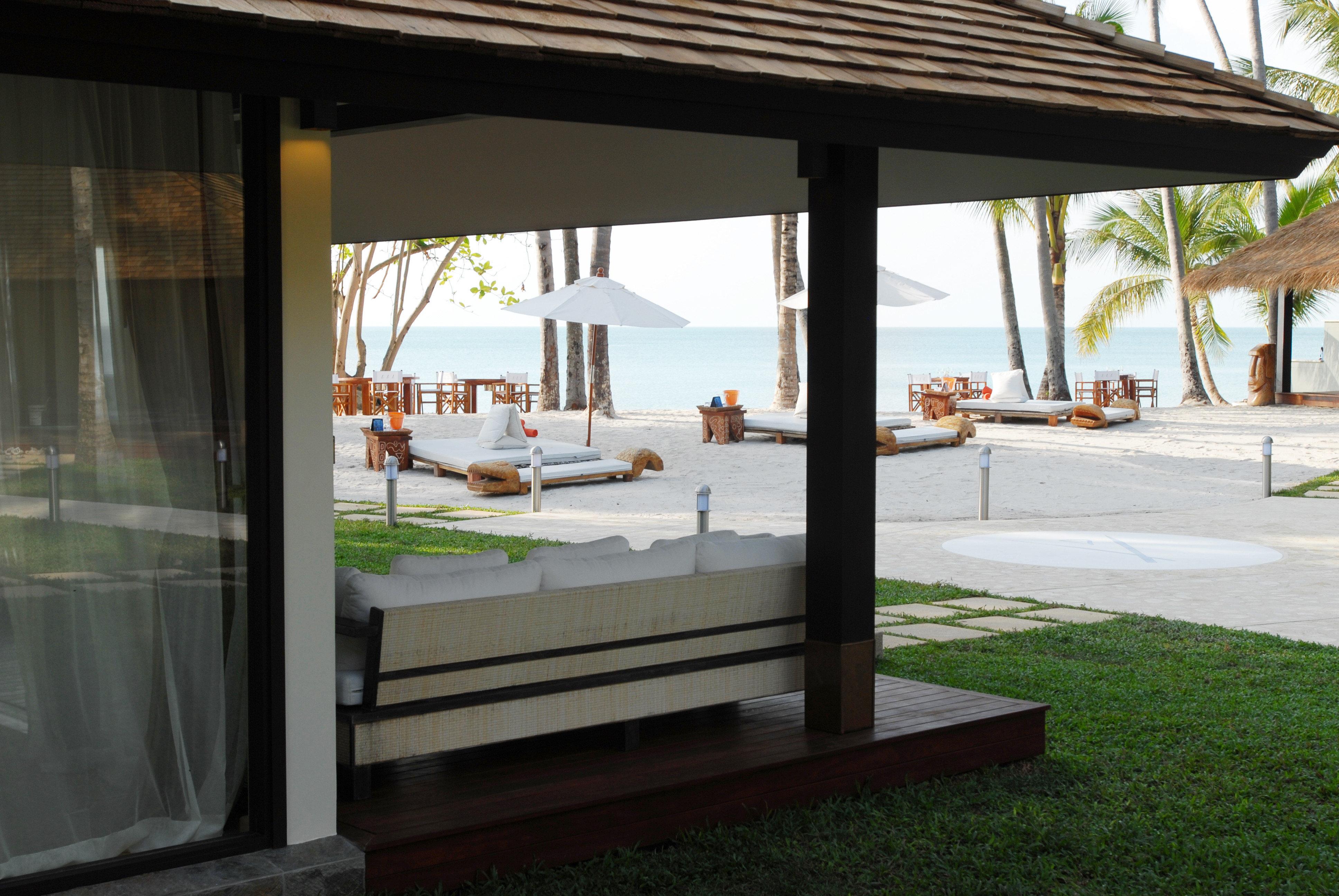 Beachfront Resort property building home outdoor structure pavilion Villa porch
