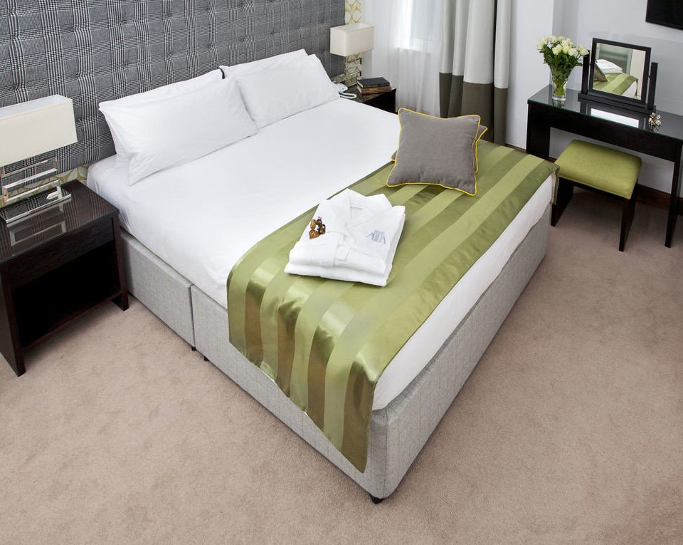 box spring green bed frame bed sheet flooring studio couch couch