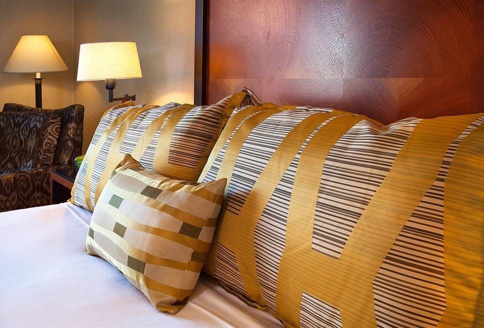 man made object yellow bed sheet living room textile bedclothes