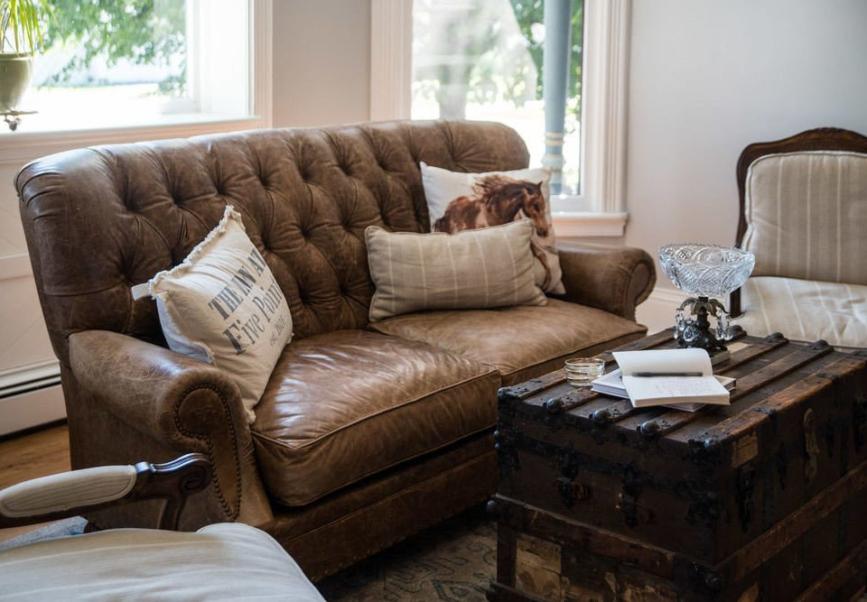 sofa living room property brown home couch hardwood loveseat leather studio couch cottage bed sheet seat tan