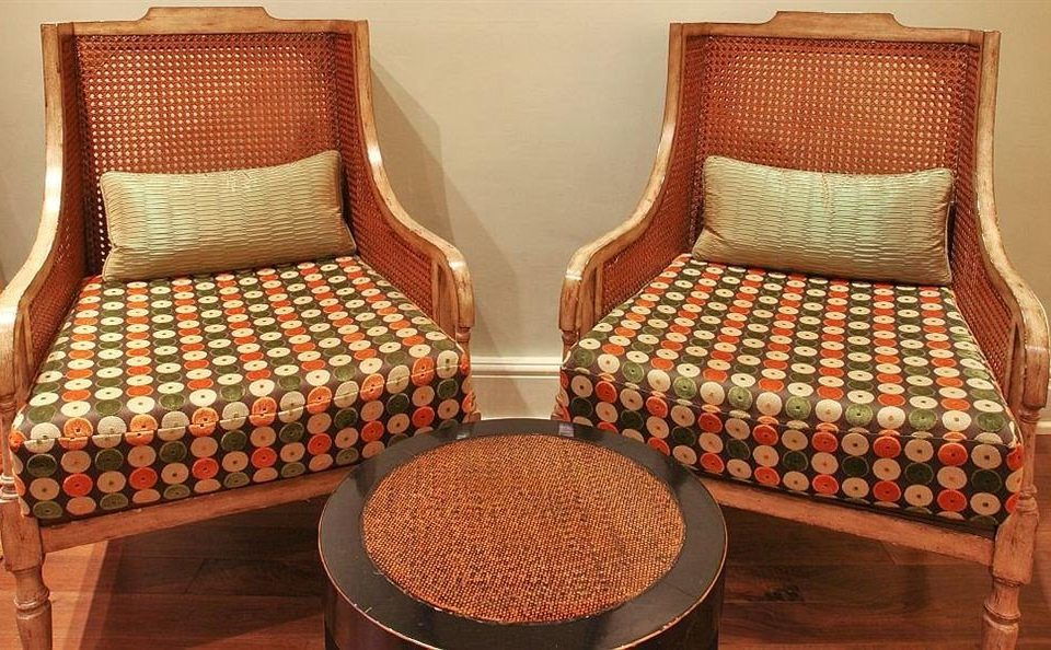 chair man made object seat product wicker flooring bed sheet textile