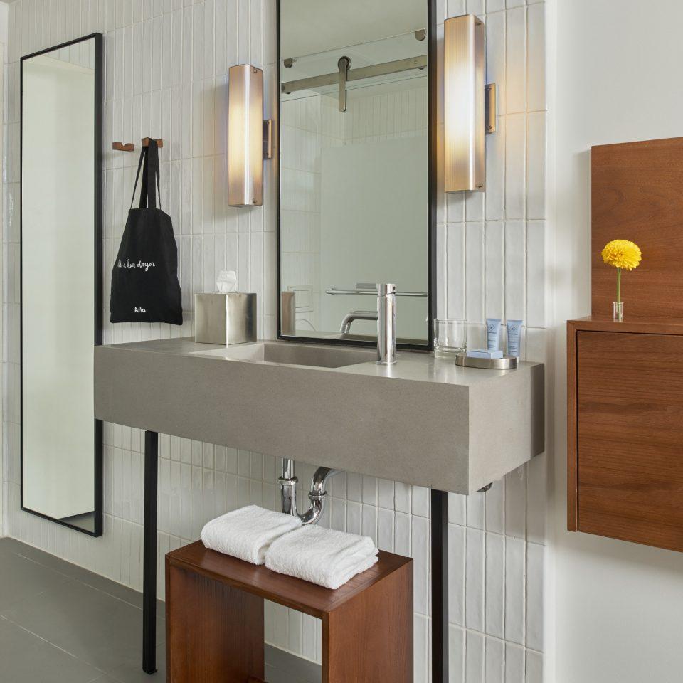 bathroom cabinetry sink wooden lighting bathroom cabinet plumbing fixture flooring Bedroom