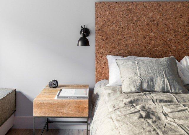 property Bedroom bed sheet flooring pillow bed frame cottage laminate flooring bedclothes tan