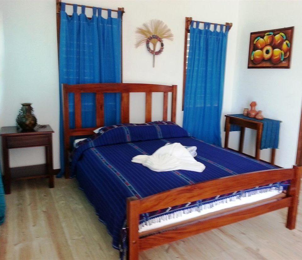 Bedroom property cottage wooden bed frame bed sheet blue