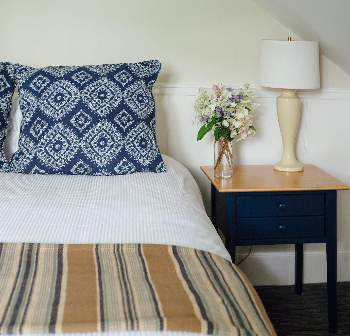 Bedroom pillow duvet cover bed sheet hardwood white bed frame cottage textile lamp