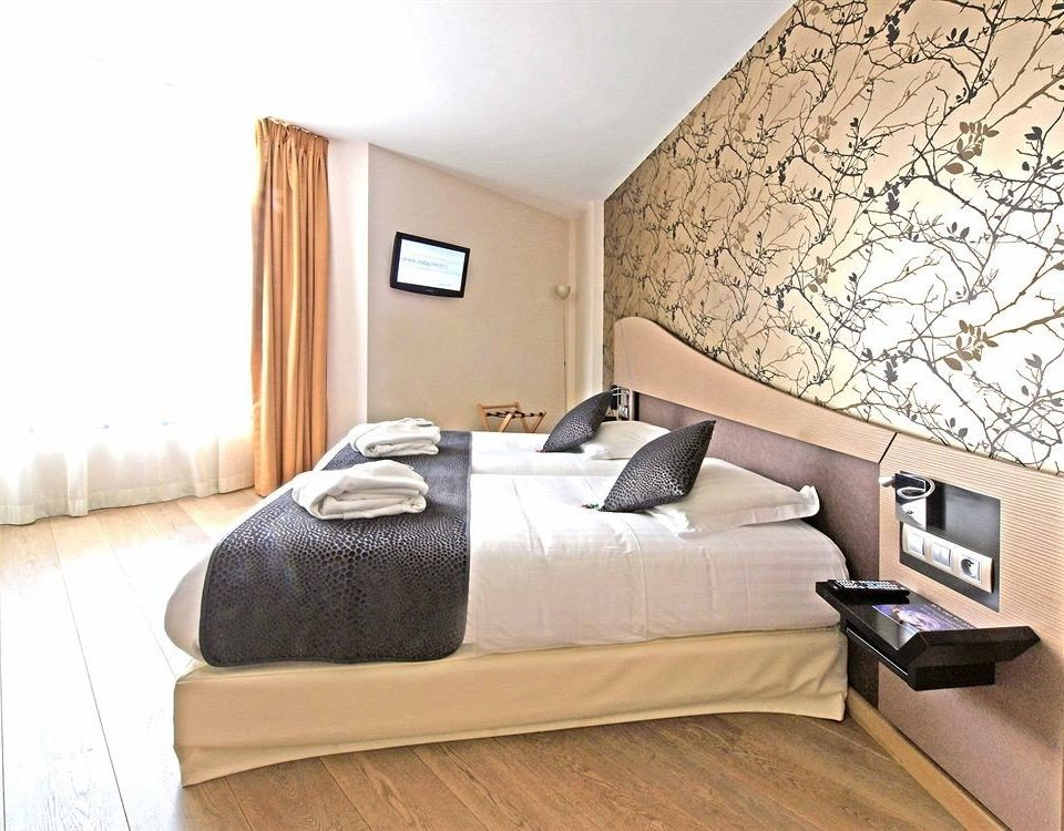 sofa property Bedroom bed frame hardwood studio couch living room bed sheet laminate flooring cottage