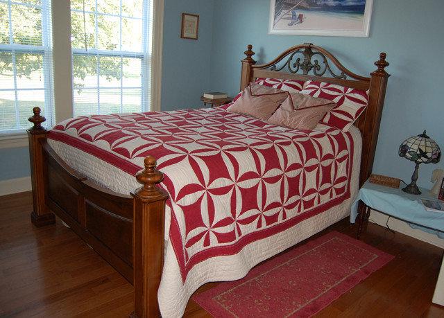 Bedroom bed sheet red duvet cover hardwood bed frame textile studio couch cottage