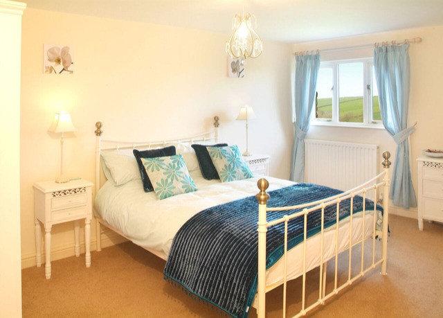 Bedroom property scene cottage home bed frame bed sheet lamp