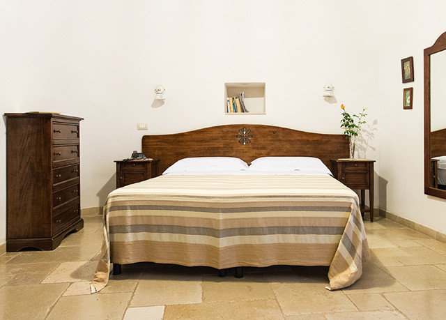 Bedroom bed frame hardwood bed sheet duvet cover studio couch textile tan
