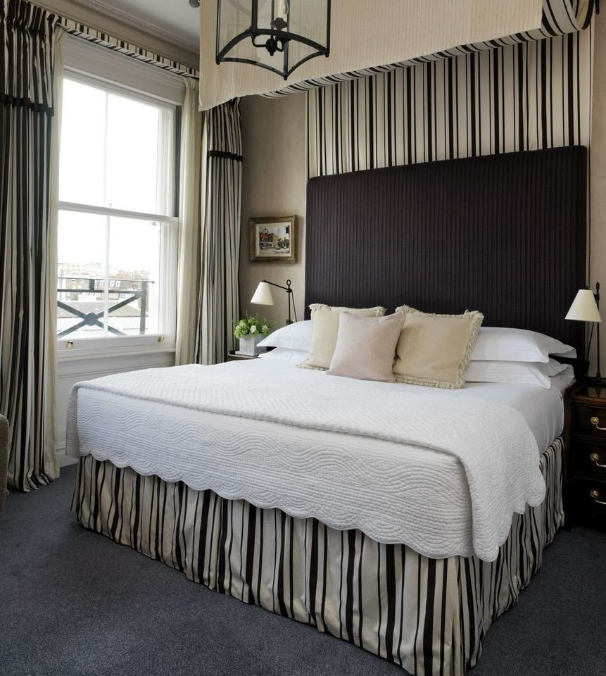 Bedroom bed frame bed sheet textile duvet cover studio couch living room
