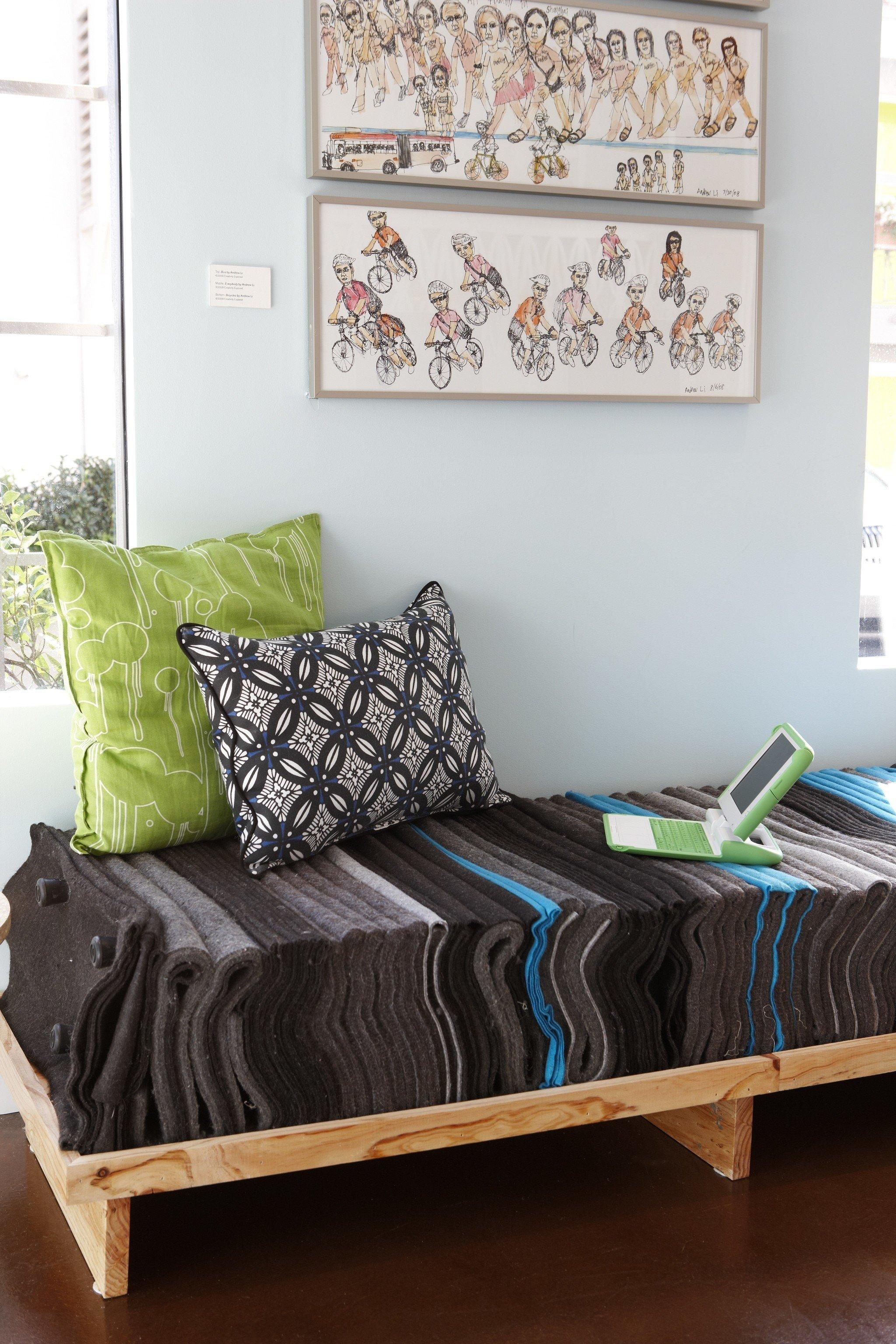 bed sheet hardwood living room bed frame studio couch pillow textile Bedroom
