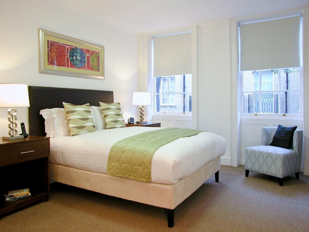 sofa Bedroom property living room bed frame home hardwood bed sheet tan