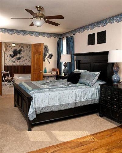 Bedroom property living room hardwood bed frame home studio couch bed sheet wood flooring