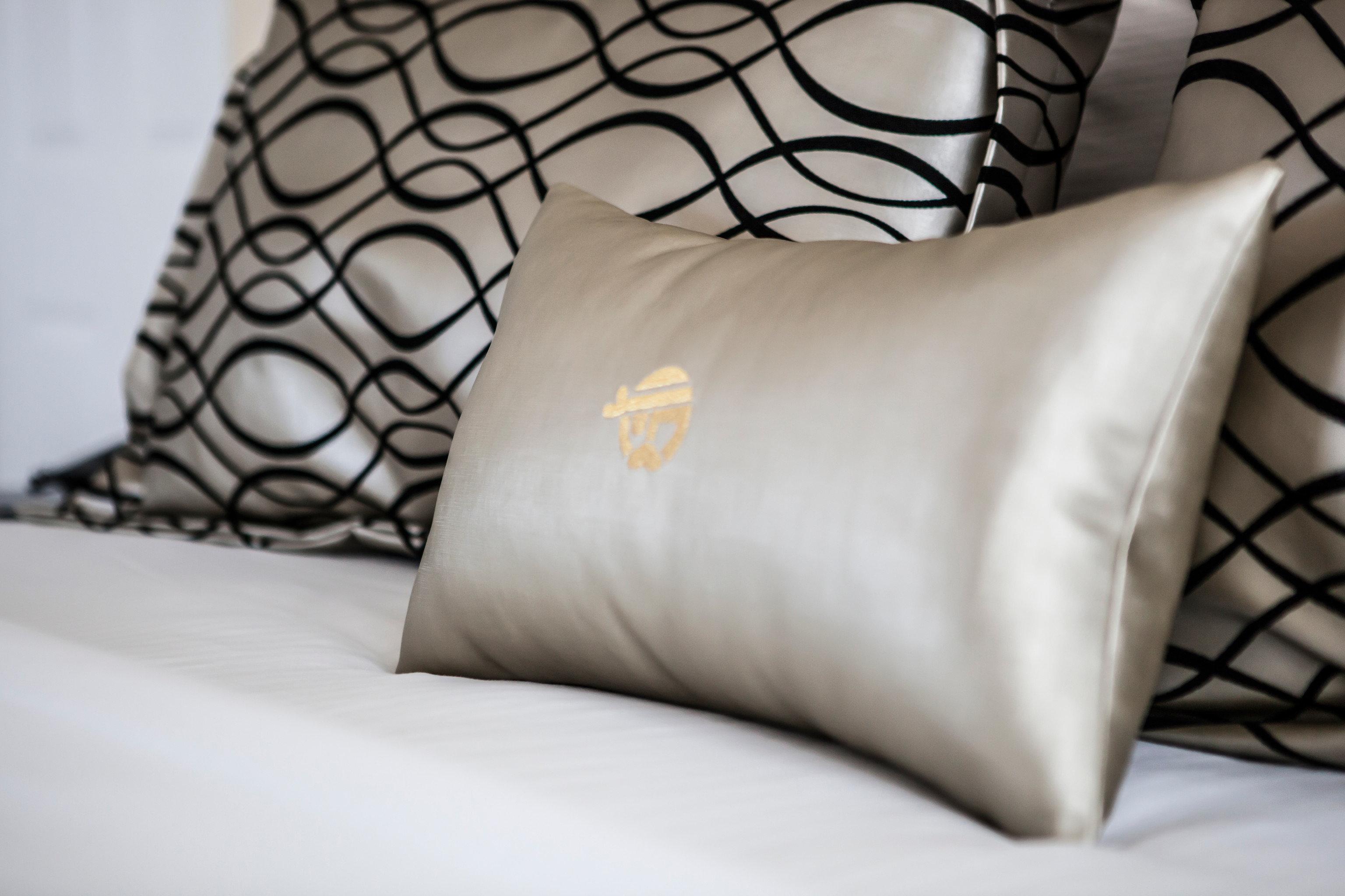 duvet cover pillow white bed sheet textile material pattern linens Bedroom lamp sofa