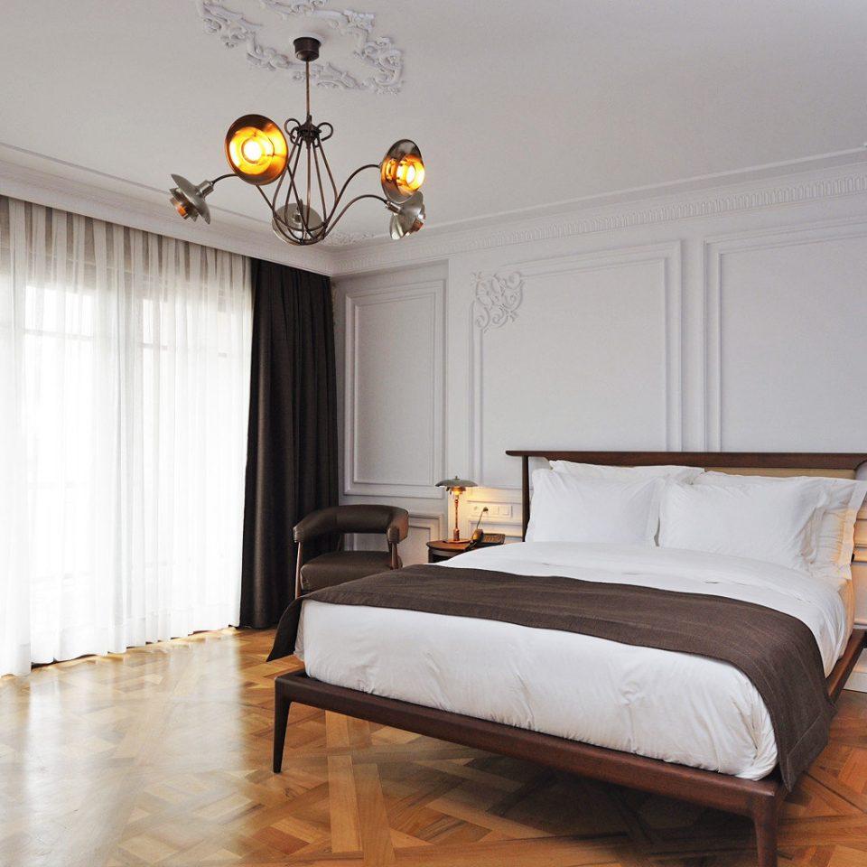 Bedroom Boutique Boutique Hotels Elegant Hotels Luxury Travel property hardwood home living room bed frame Suite bed sheet wood flooring