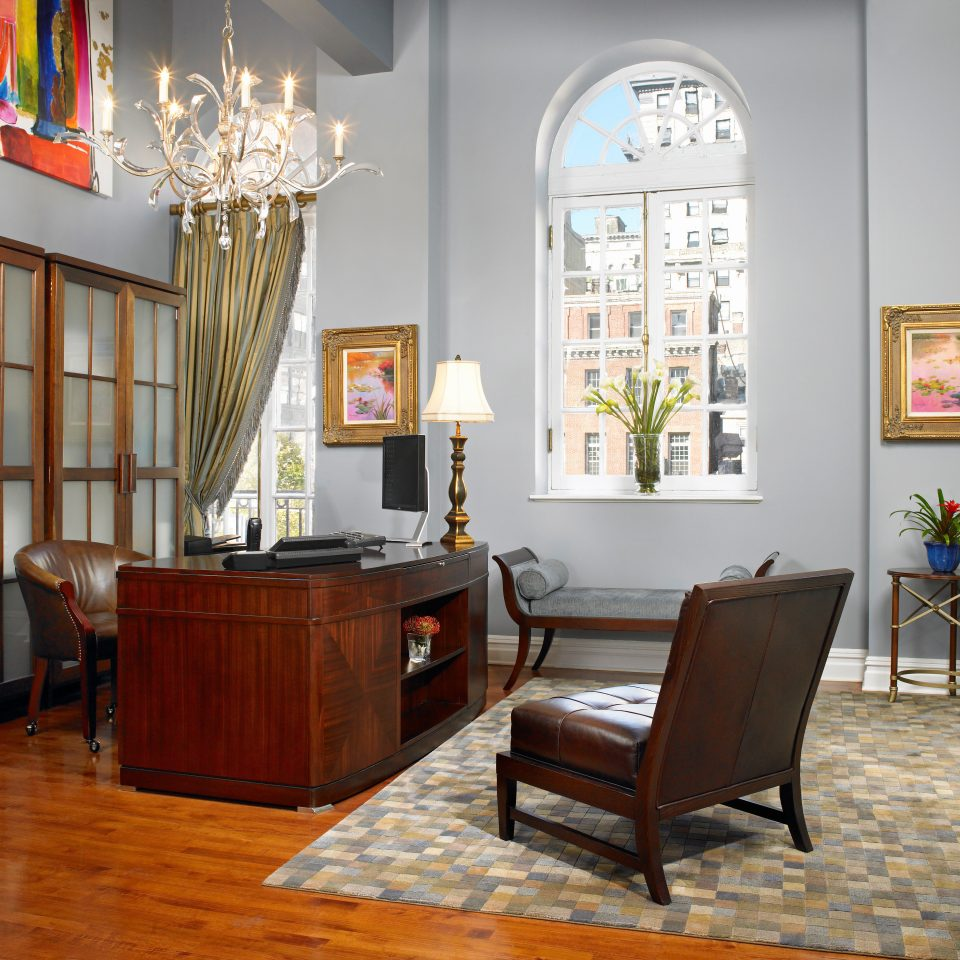 Boutique City Lobby Lounge living room property chair home hardwood wood flooring flooring cottage Bedroom