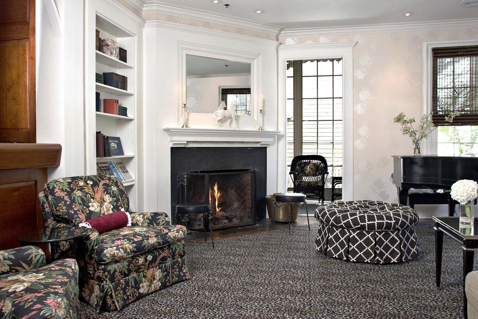 Boutique Fireplace Lounge Modern sofa fire living room property home cottage hardwood Bedroom leather