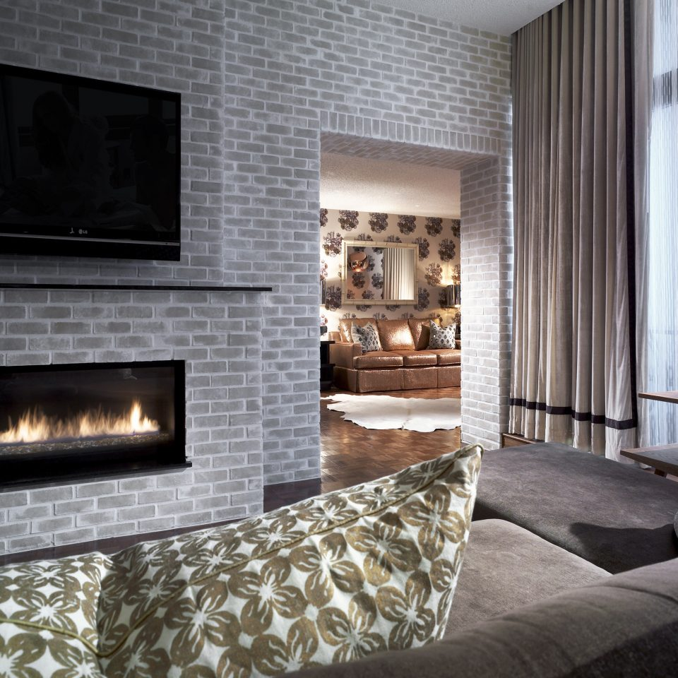 Bedroom Boutique Fireplace Modern Penthouse Suite sofa fire property hearth living room home stone