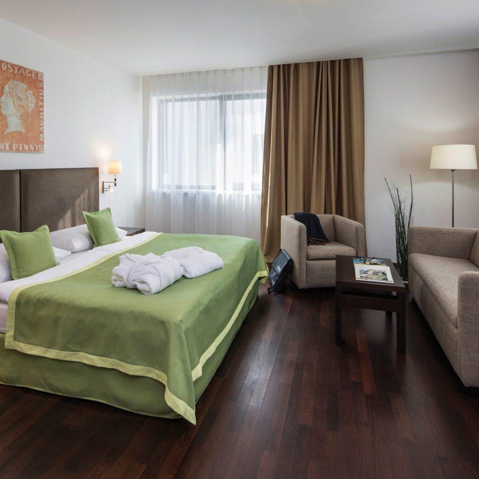 Bedroom Boutique Hip Modern sofa property green Suite hardwood cottage living room