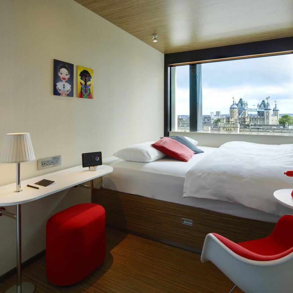 Bedroom Boutique city views cozy Hip interior trendy view red property Suite living room home cottage condominium