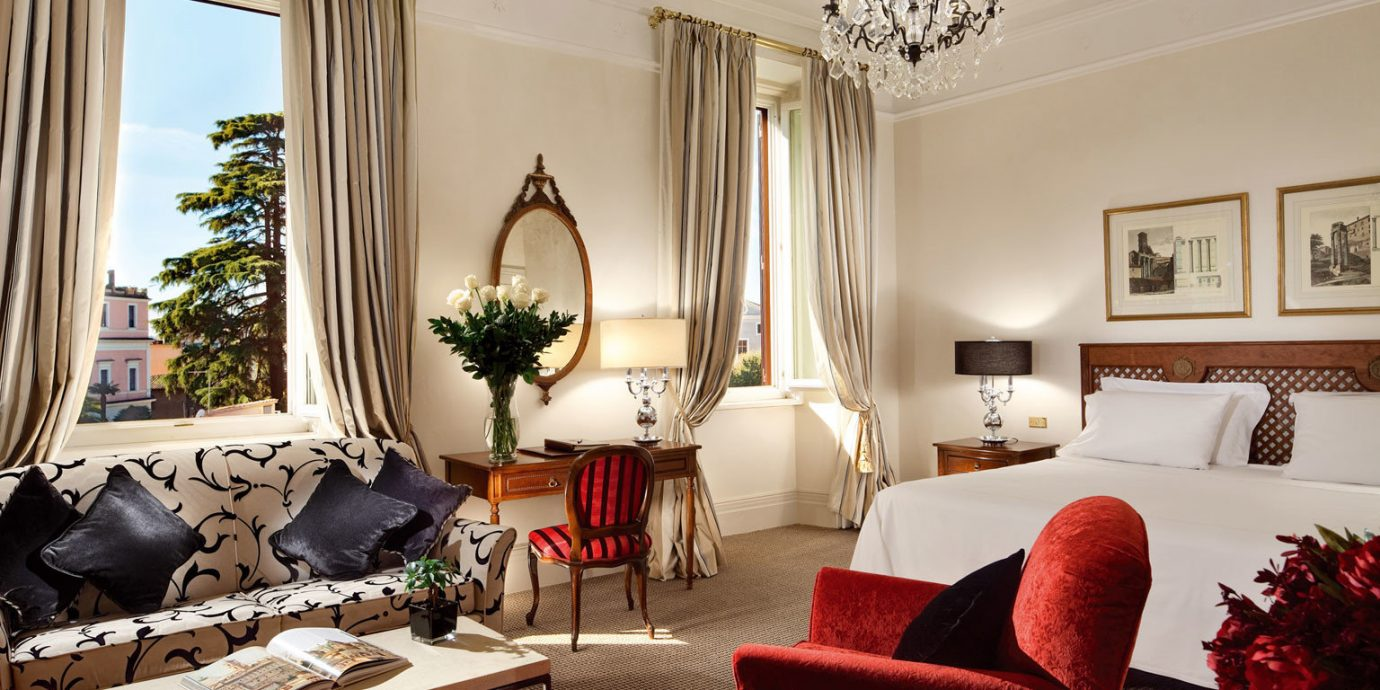 Bedroom Boutique Hotels City Classic Elegant Hotels Italy Luxury Luxury Travel Romance Romantic Romantic Hotels Rome Scenic views Suite sofa living room red property chair home cottage Villa mansion leather