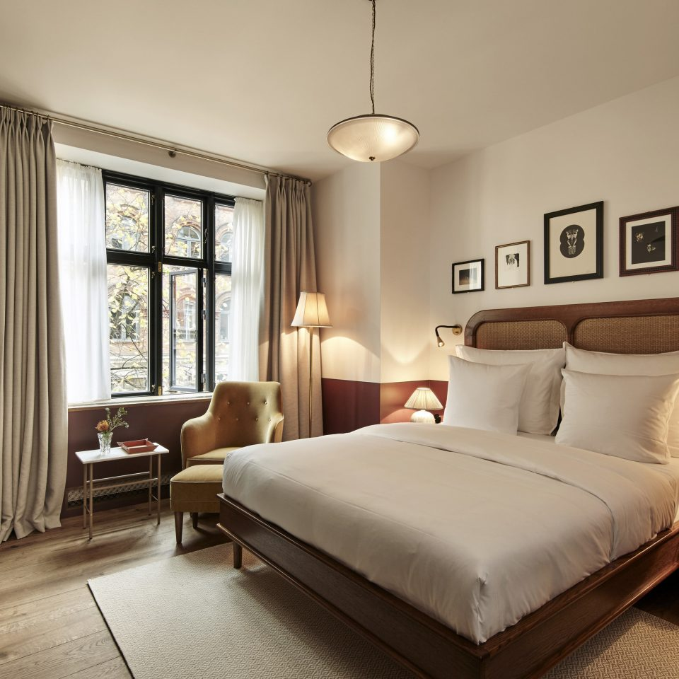 Boutique Hotels Copenhagen Denmark Hotels sofa Bedroom property bed frame Suite home flooring bed sheet lamp