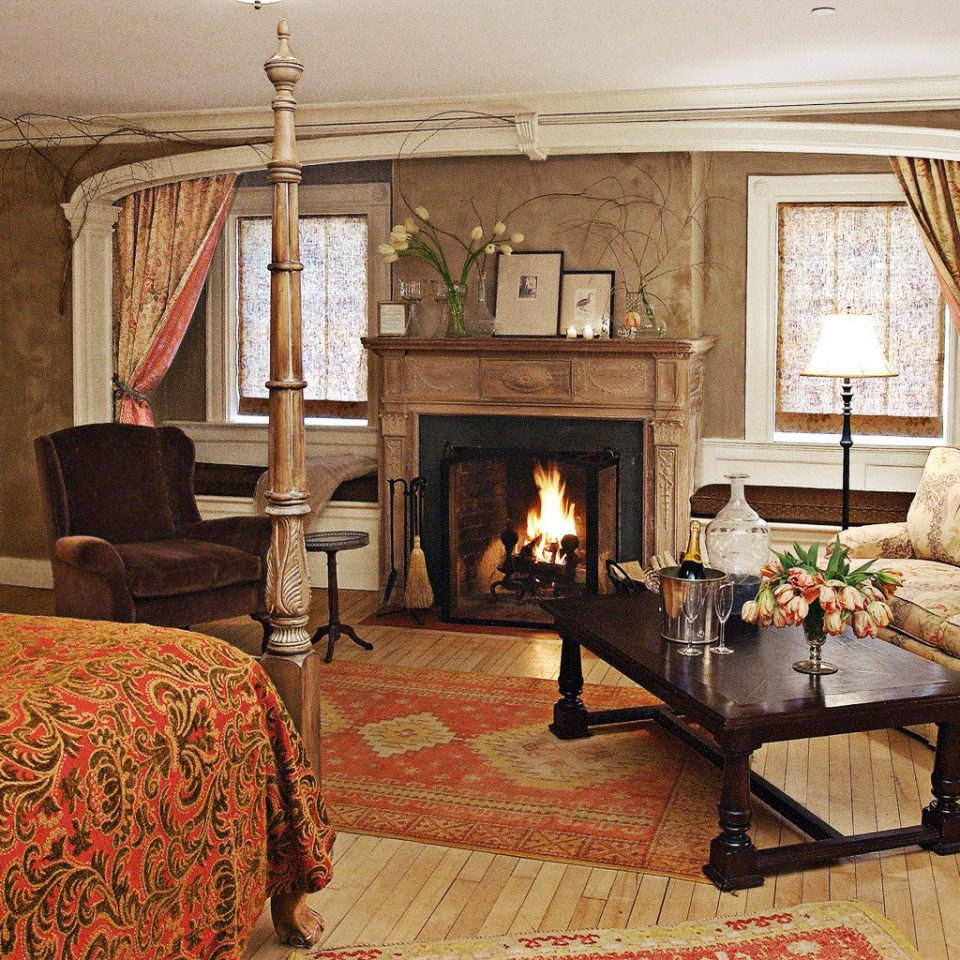 Bedroom Boutique Hotels Country Fireplace Romance Romantic Trip Ideas Winter sofa living room property home house cottage hardwood Suite farmhouse