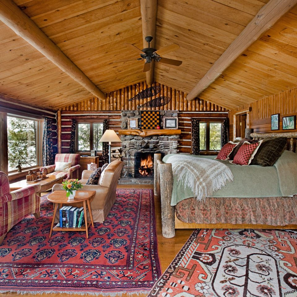 alpine skiing Bedroom Boutique Hotels East Coast USA Hotels Lake Lakes + Rivers Lodge Outdoors + Adventure Rustic Scenic views Trip Ideas Waterfront Weekend Getaways property log cabin cottage Resort living room home rug