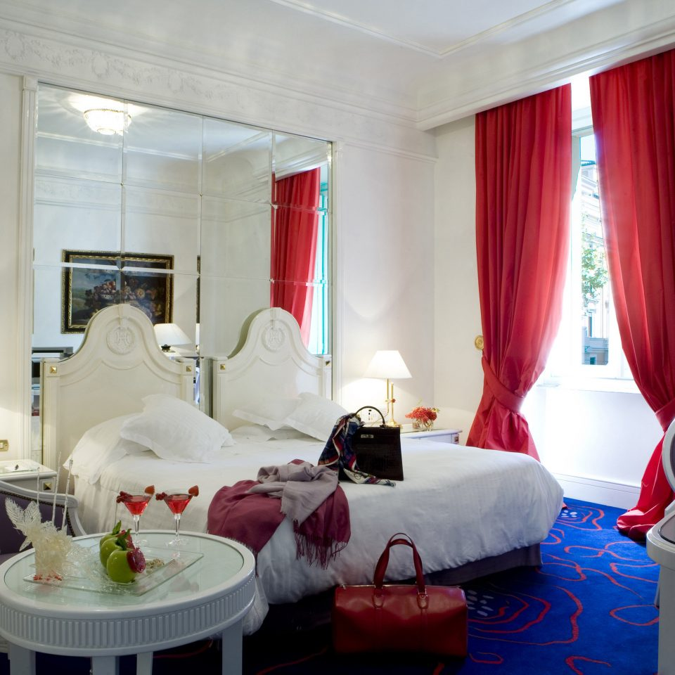 Boutique Hotels Italy Luxury Travel Romantic Hotels Rome property curtain Suite red Bedroom living room cottage flat cluttered