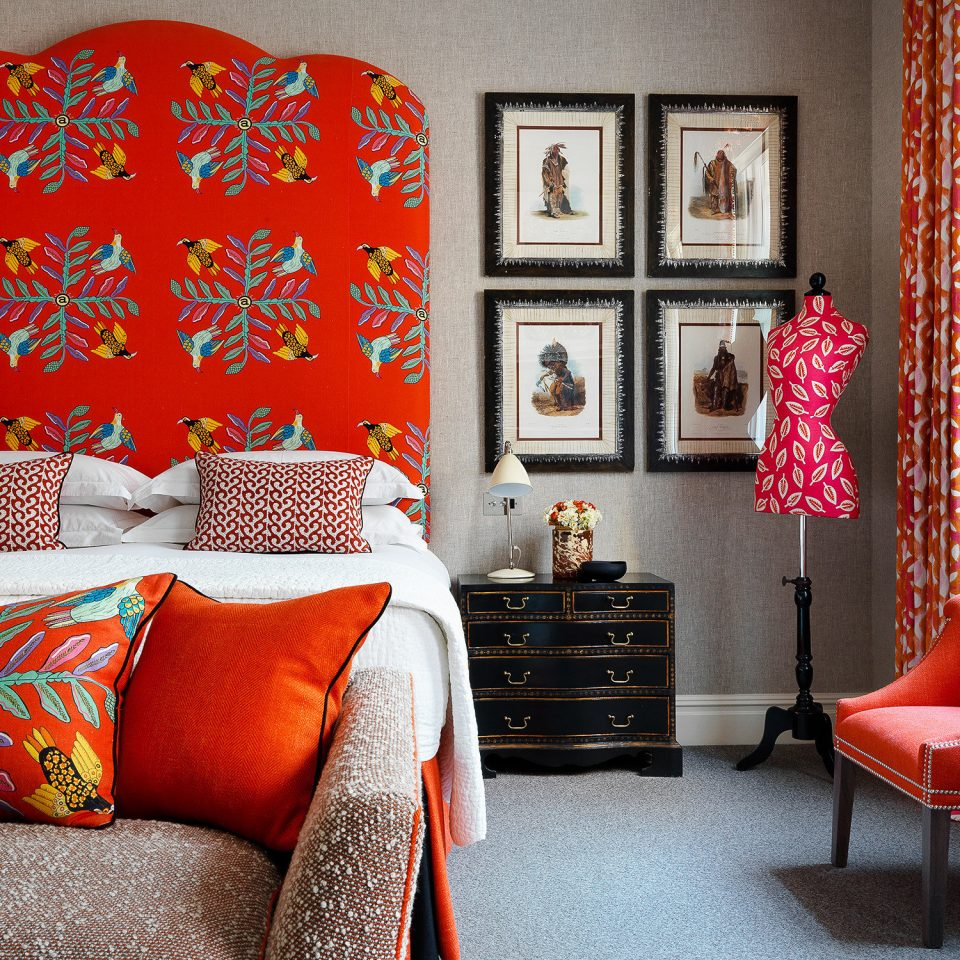 Boutique Hotels London Romantic Hotels red sofa chair living room home textile colorful pattern couch Bedroom curtain decor linens orange bed sheet bright colored leather