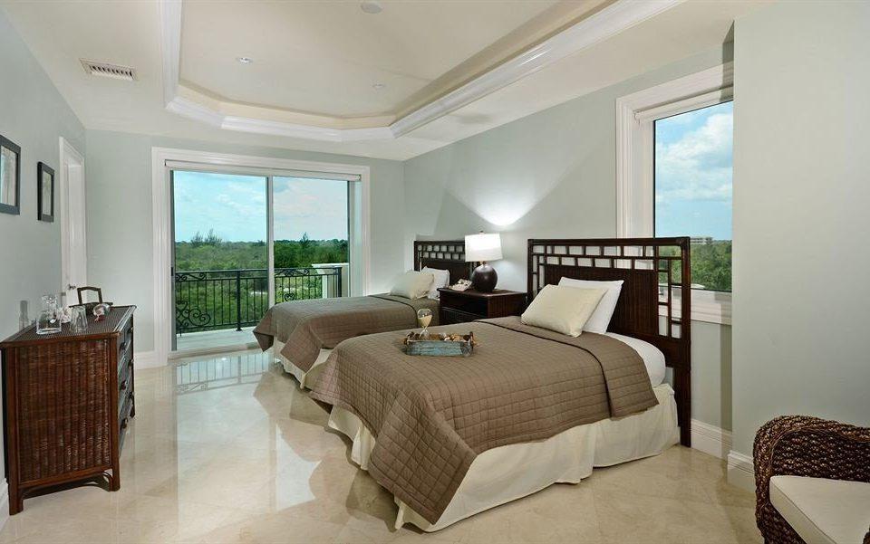 Bedroom Boutique Modern Patio Waterfront property Suite home condominium living room cottage Villa