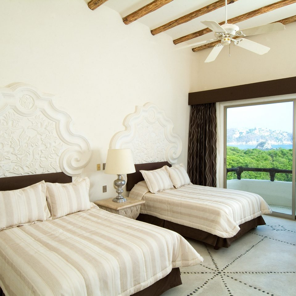 Bedroom Boutique Rustic Scenic views Waterfront property Suite living room cottage Villa