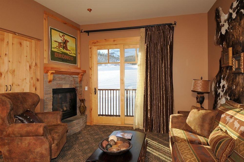 sofa property living room brown home Bedroom cottage hardwood farmhouse leather