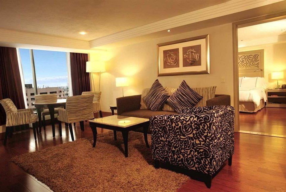 Bedroom Business Modern property Suite living room hardwood cottage Villa recreation room Resort dining table