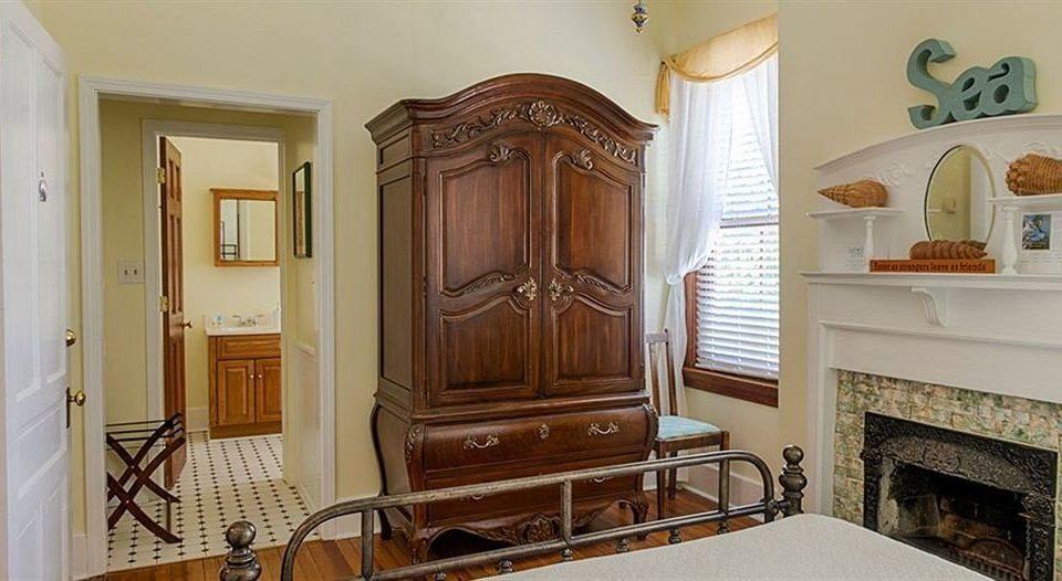 property cabinetry hardwood home cottage living room molding mansion Bedroom