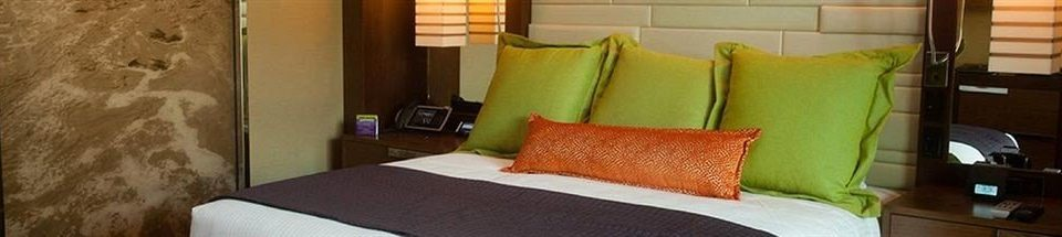 Bedroom Casino sofa property pillow cottage Suite bed sheet containing