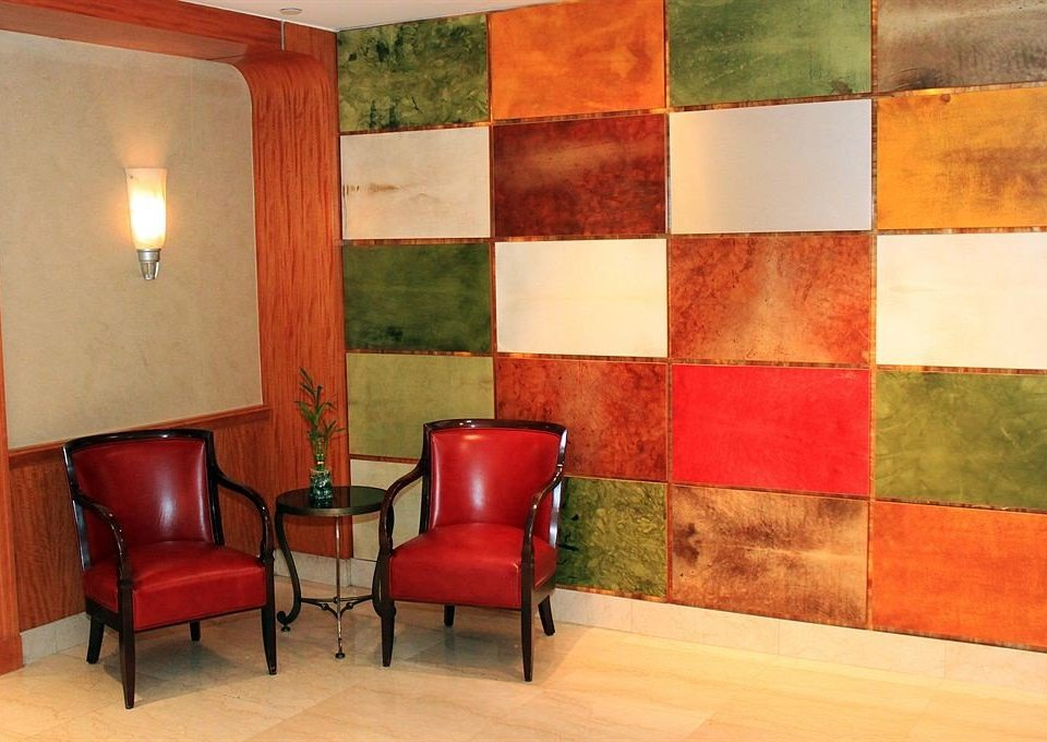 red color chair hardwood flooring living room Bedroom
