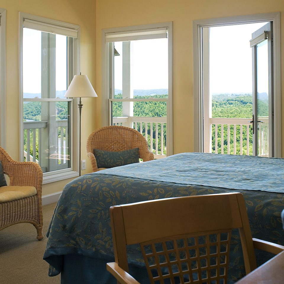 Bedroom Classic Country Inn Scenic views Suite property chair home living room house porch cottage hardwood Villa farmhouse condominium