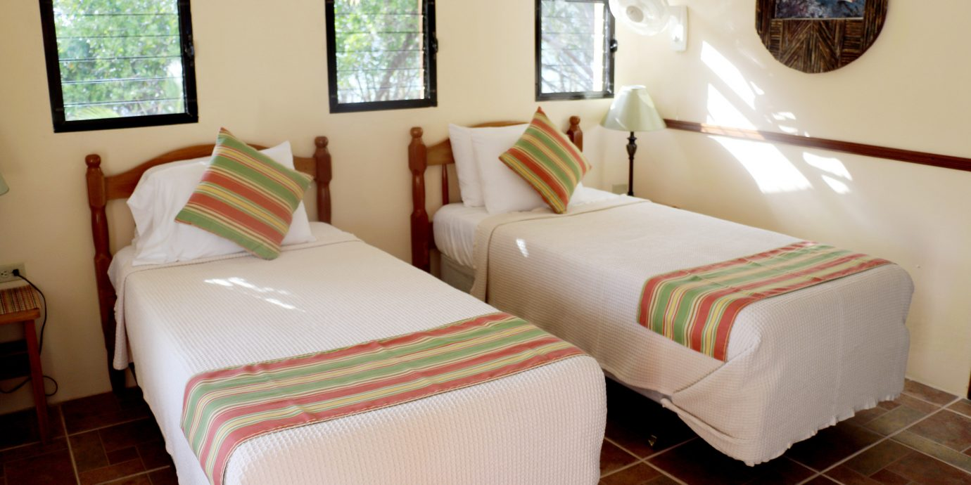Bedroom Classic Eco Resort property cottage Suite bed sheet