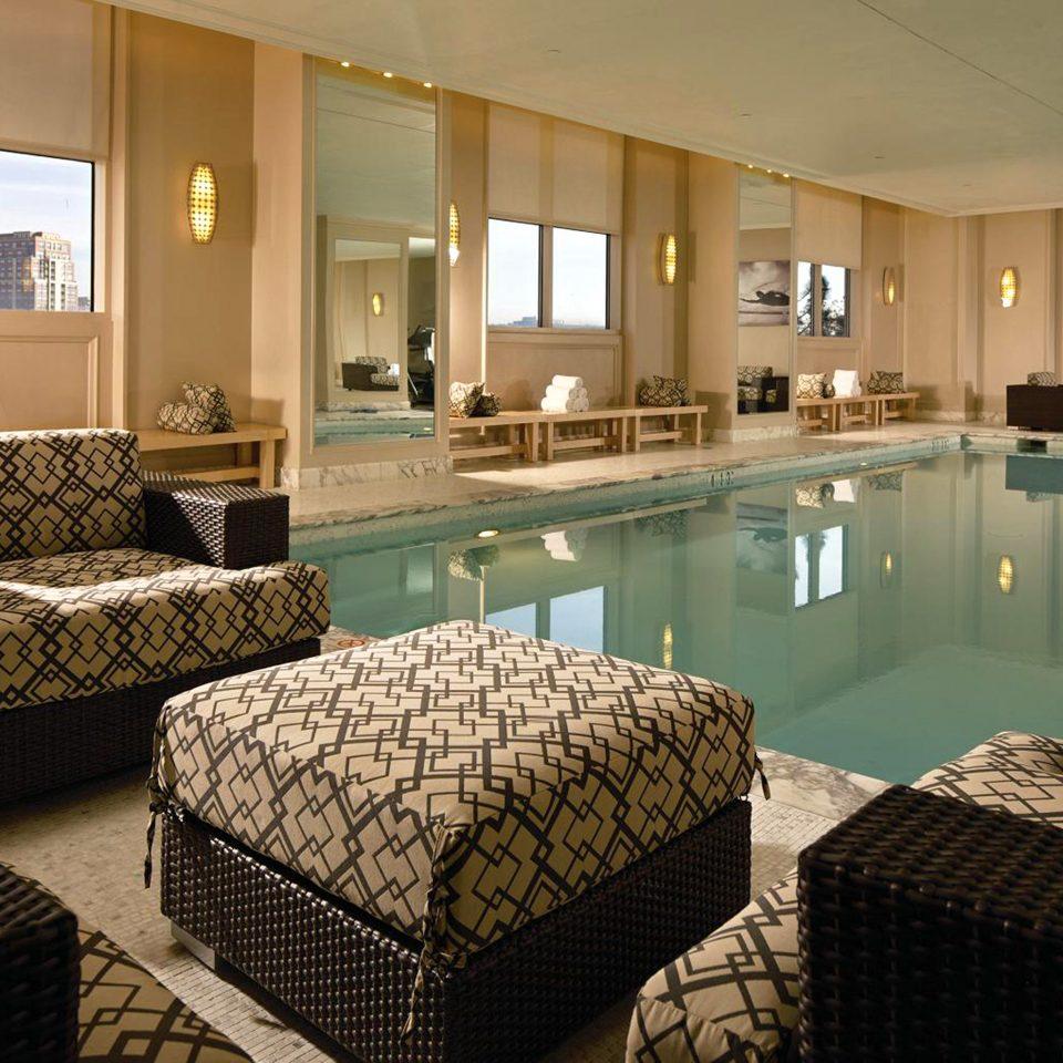 Classic Elegant Lounge Patio Pool property swimming pool condominium living room Suite Villa Resort Bedroom