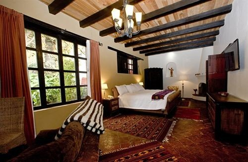 Bedroom Classic Elegant Luxury Rustic Suite property cottage Villa hardwood living room Resort farmhouse rug