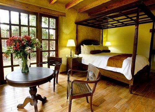 Bedroom Classic Elegant Luxury Rustic Suite property hardwood cottage Villa home living room farmhouse wood flooring Resort