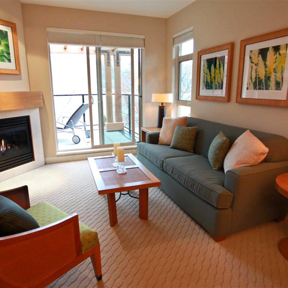 Classic Fireplace Resort chair property living room home cottage hardwood Suite condominium Villa Bedroom