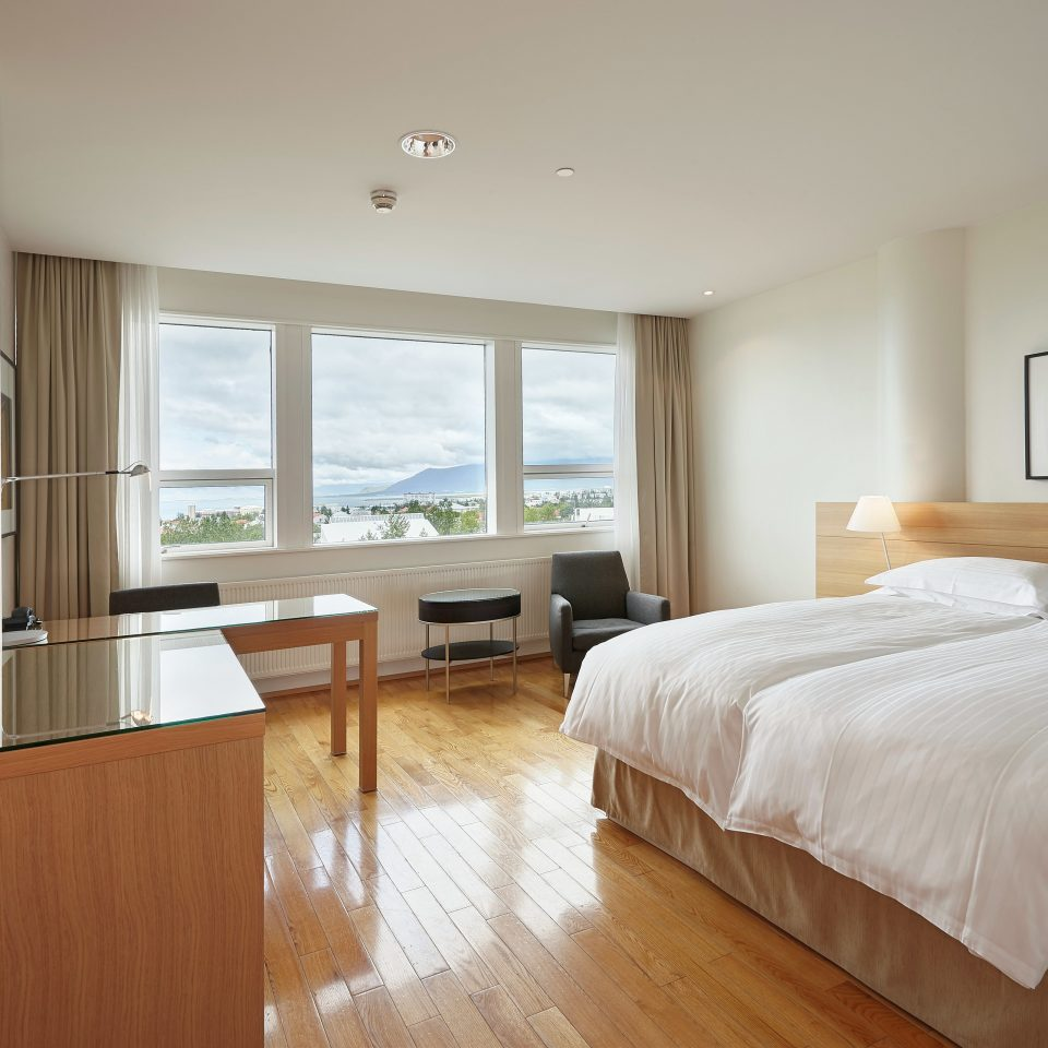 Bedroom Classic Hotels Iceland Modern Scenic views Waterfront property scene home hardwood cottage Suite