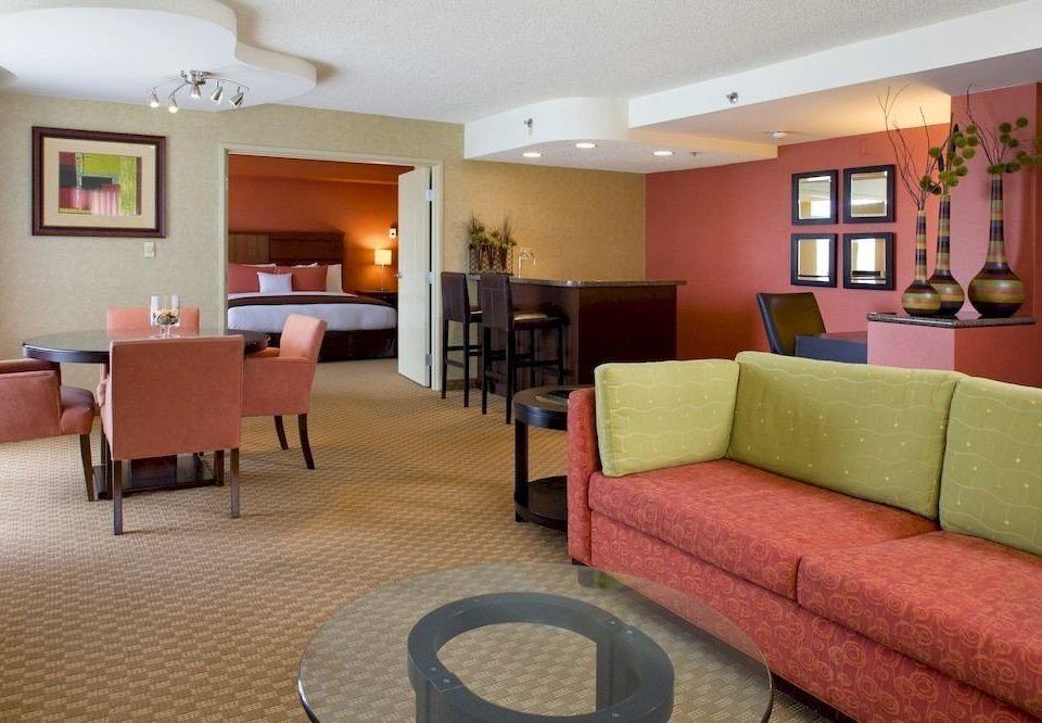 Bedroom Classic Resort chair property Suite living room condominium recreation room Lobby waiting room Villa