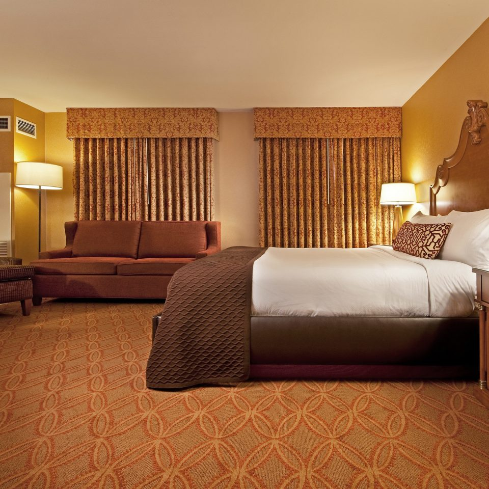 Bedroom Classic Resort sofa property Suite living room condominium home cottage containing tan
