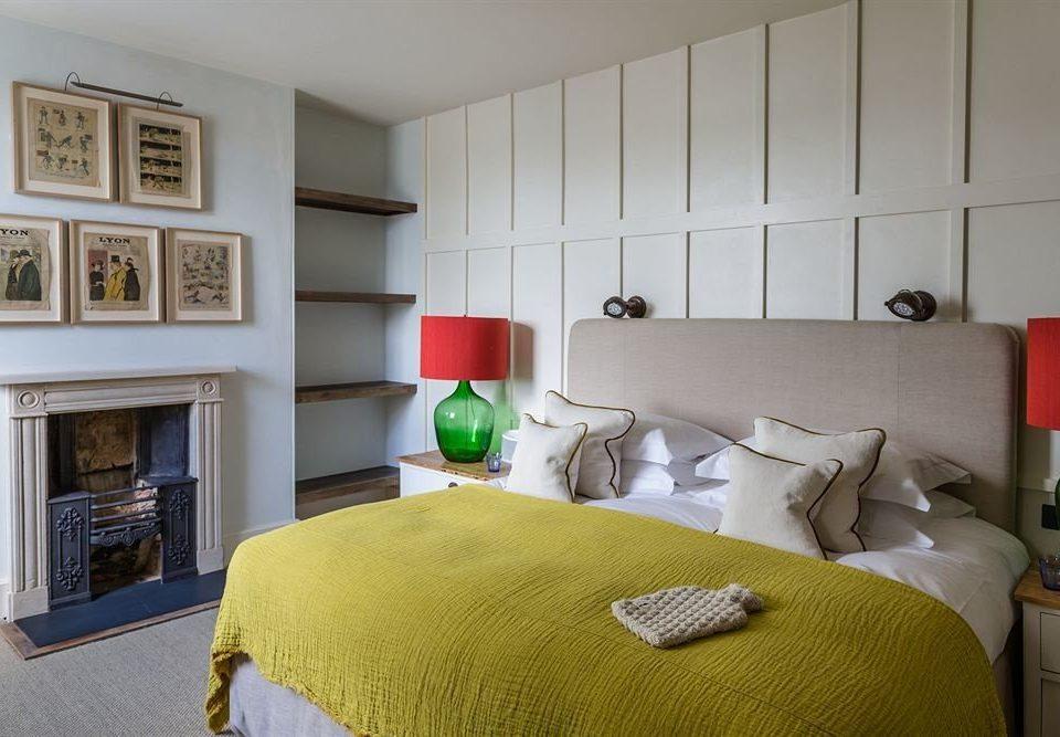 sofa property Bedroom home cottage living room green condominium pillow